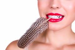 Красные губы и перо Стоковая Фотография