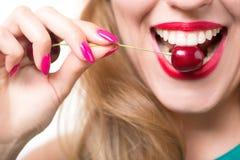 Красные губы с вишней Стоковая Фотография