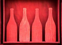 Красные деревянные выходы отрезка силуэта бутылки Стоковое Изображение RF