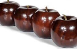 Красные деревянные яблоки Стоковые Изображения