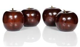 Красные деревянные яблоки Стоковое фото RF