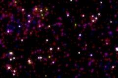Красные звезды на темной предпосылке Стоковое Фото