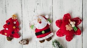 Красные игрушки рождества на белой предпосылке Стоковая Фотография