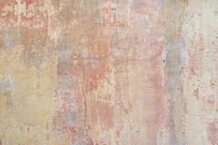 Красные и желтые краски на старой стене Стоковое фото RF