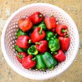 Красные и зеленые перцы Стоковое Изображение
