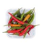 Красные и зеленые перцы chili в стеклянном шаре Стоковые Изображения