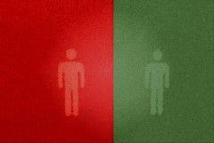Красные и зеленые пешеходные знаки (используя туалет) Стоковое Изображение RF