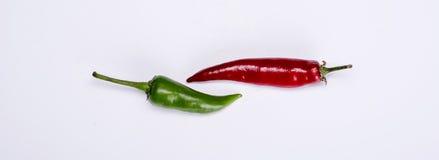 Красные и зеленые pepers Стоковые Изображения