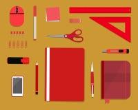 Красные канцелярские принадлежности на желтой предпосылке Стоковое Изображение