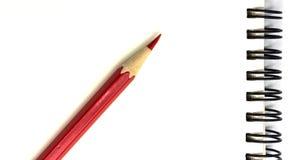 Красные карандаш и тетрадь Стоковая Фотография
