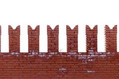 Красные кирпичи в стене Кремля на белой предпосылке стоковые изображения