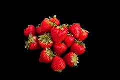 Красные клубники на черной предпосылке Стоковая Фотография