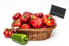 Красные перцы в корзине магазина Стоковое Изображение