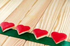 Красные печенья рождества в форме сердца Стоковая Фотография