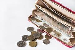 Красные портмоне и монетка и деньги Стоковое Изображение
