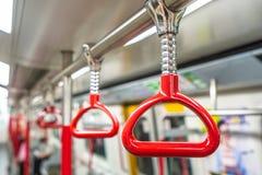 Красные поручни в метро стоковое фото rf