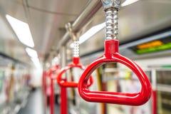 Красные поручни в метро стоковые изображения rf