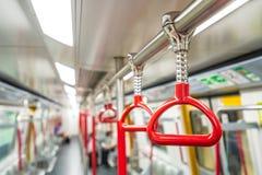 Красные поручни в метро стоковое изображение rf