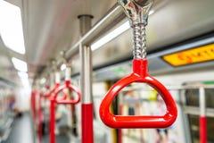 Красные поручни в метро стоковые фотографии rf