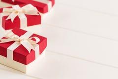 Красные подарочные коробки на белой предпосылке Стоковая Фотография RF
