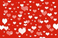 Красные предпосылка и сердце Стоковая Фотография