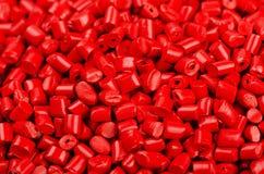 Красные пластичные зерна Стоковая Фотография RF