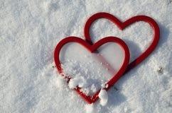 Красные пластичные сердца Стоковые Фото