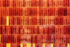 Красные плиты с надписями на стене Стоковые Фото