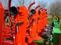 Красные роторные косилки Стоковая Фотография
