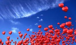 Красные сердца влюбленности в голубом небе Стоковое фото RF
