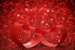 Красные сердца ленты на ярких блесках Стоковое Изображение