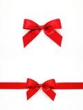 Красные смычки и лента подарка Стоковая Фотография
