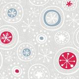 Красные снежинки голубого серого цвета на сером цвете Стоковые Фото