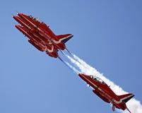 Красные стрелки летая в образование Стоковая Фотография RF