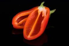 Красные сладостные перцы изолированные на черноте Стоковая Фотография