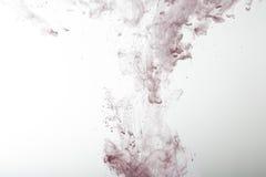 Красные чернила в предпосылке конспекта воды Стоковое Изображение