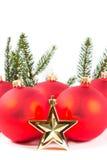 Красные шарики рождества и ветвь ели Стоковая Фотография