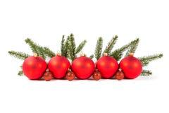 Красные шарики рождества и ветвь ели Стоковое Изображение