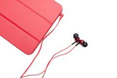 Красные штепсельные вилки таблетки и наушника Стоковые Изображения RF