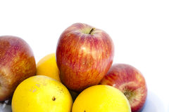 Красные яблоки и померанцы Стоковое Фото