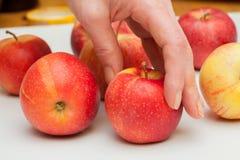 Красные яблоки на таблице Стоковое Изображение RF