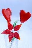 Красные lollipops формы сердца в стекле Стоковое Фото