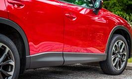 Красный автомобиль Стоковые Изображения