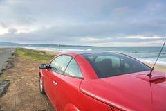 Красный автомобиль на пляже Стоковая Фотография