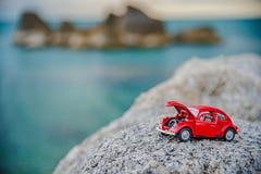 Красный автомобиль на скале Стоковая Фотография RF