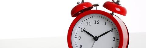 Красный будильник изолированный на белизне Стоковое фото RF