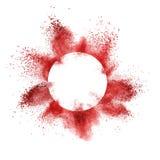 Красный взрыв порошка за круглой рамкой взрывая на белой предпосылке стоковая фотография rf