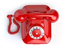 Красный винтажный телефон на белизне Взгляд сверху телефона Стоковое фото RF