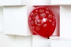 Красный воздушный шар на белой предпосылке Стоковое Изображение RF