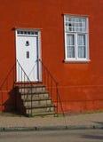 Красный вход дома Стоковая Фотография